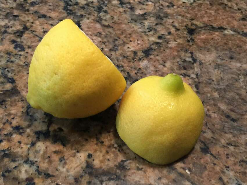 2. I love lemons! I have eaten so many over the years that my two front teeth are bonded because of lost enamel.