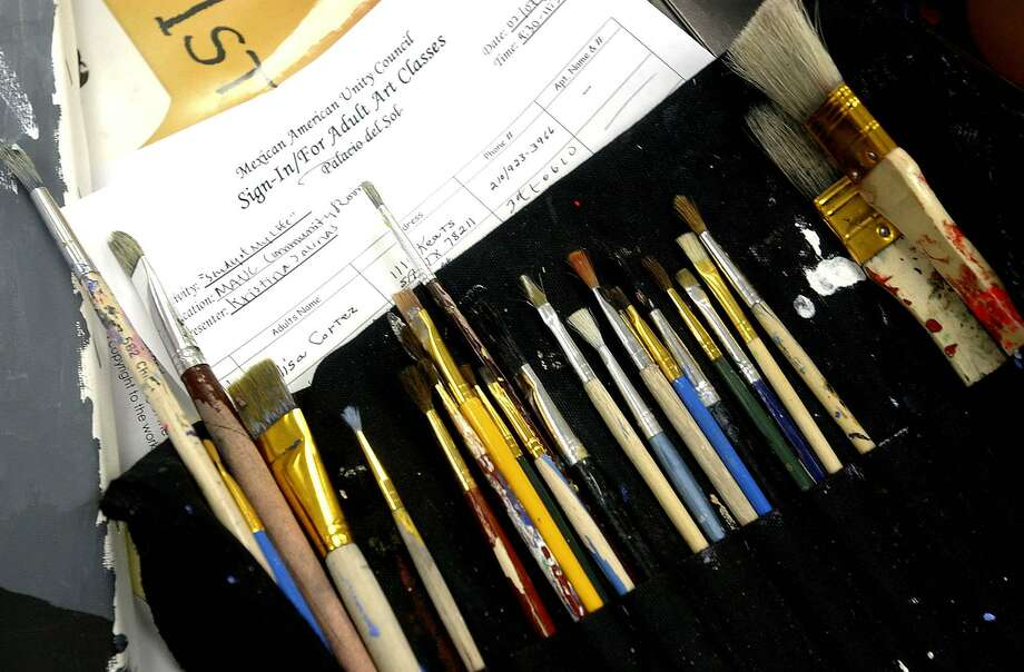 CONEXION: Paintbrushes sit on a table for student use in art classes at the Mexican American Unity Council. The City of San Antonio recently funded art classes for adults on the West Side, but has had a hard time getting students. The classes are free and offered every week. Students get to paint or sketch for two hours. Helen L. Montoya/Staff Photo: HELEN L. MONTOYA, STAFF / SAN ANTONIO EXPRESS-NEWS / SAN ANTONIO EXPRESS-NEWS