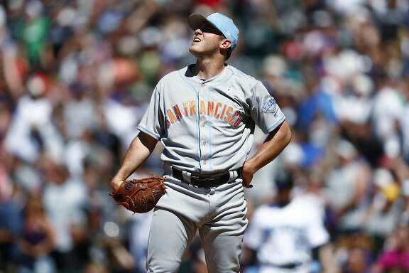 San Francisco Giants starting pitcher Ty Blach follows the flight of a solo home run that he gave up to Colorado Rockies pinch-hitter Pat Valaika in the seventh inning of a baseball game Sunday, June 18, 2017, in Denver. (AP Photo/David Zalubowski)