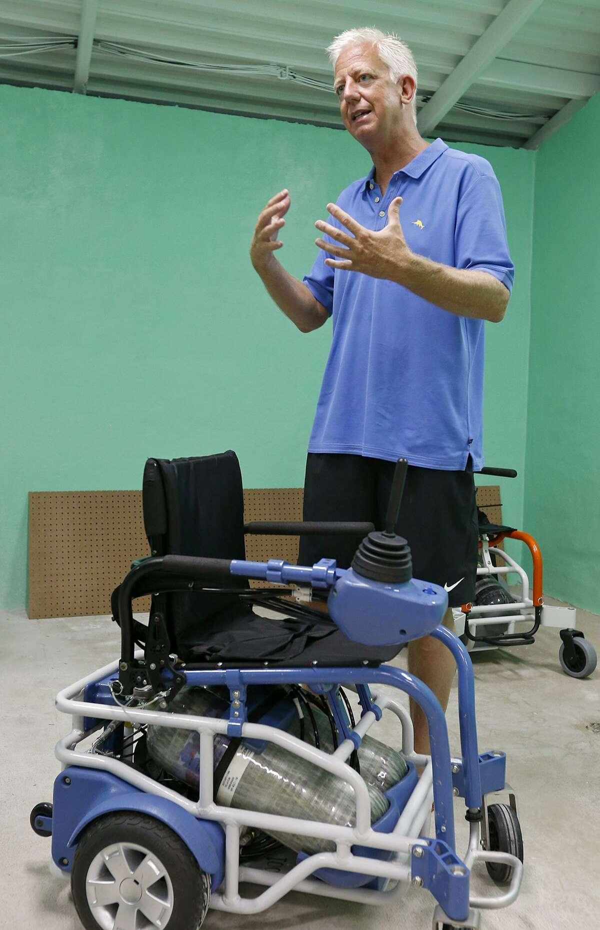 Morgan's Wonderland founder Gordon Hartman shows pneumatic wheelchairs used at Morgan?•s Inspiration Island Sunday June 18, 2017 at the splash park.