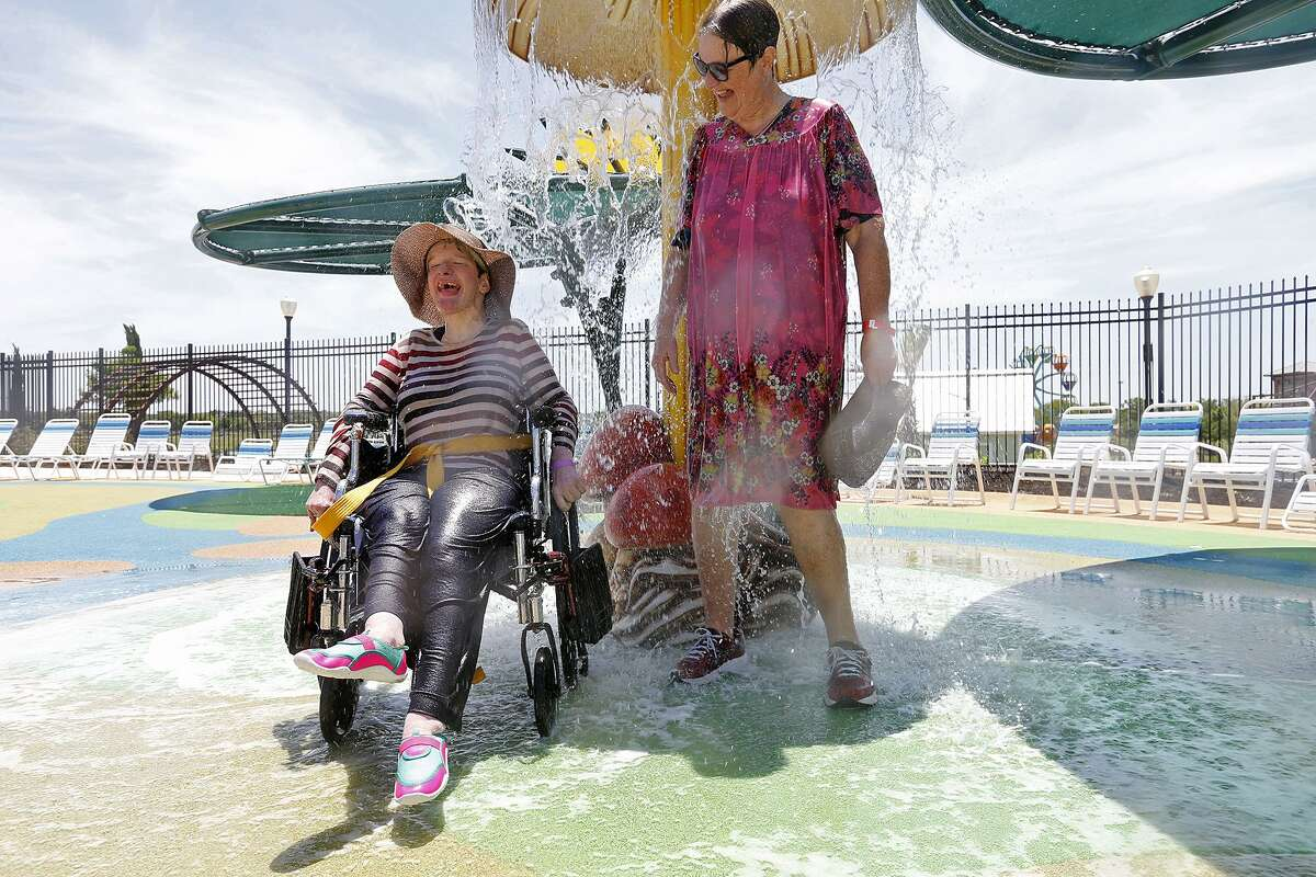 Cindy Dolder (left) and her mother Judy Rhoads enjoy Calypso Cove on June 18. The water feature is part of Morgan's Inspiration Island at Morgan's Wonderland.
