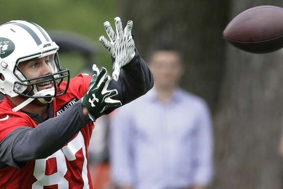 FILE - This May 23, 2017 file photo shows New York Jets wide receiver Eric Decker catching a pass during the team's organized team activities at its NFL football training facility in Florham Park, N.J. The New York Jets have released Decker, six days after saying they would do so if they couldn't work out a trade. The announcement Monday, June 12, 2017 officially ends his tenure with the team after three seasons. (AP Photo/Julio Cortez, file)