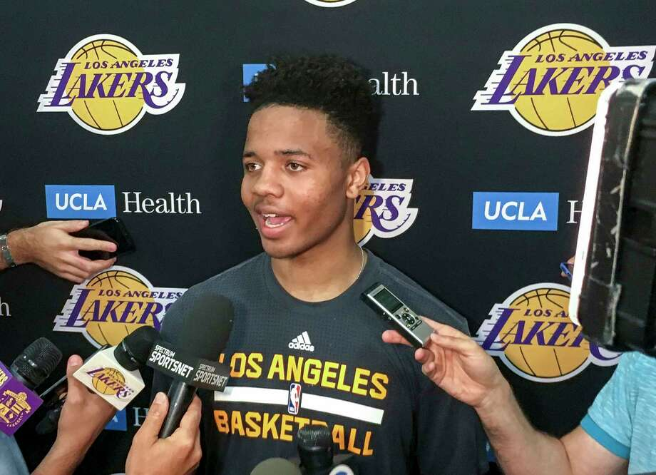 Markelle Fultz, center, speaks with reporters after his private workout with the Los Angeles Lakers at NBA basketball team's training complex Thursday, June 15, 2017, in El Segundo, Calif. The University of Washington guard could be the No. 1 pick in the NBA draft by the Boston Celtics, or he could be available to the Los Angeles Lakers with the second overall pick. (AP Photo/Greg Beacham) Photo: Greg Beacham, STF / Copyright 2017 The Associated Press. All rights reserved.