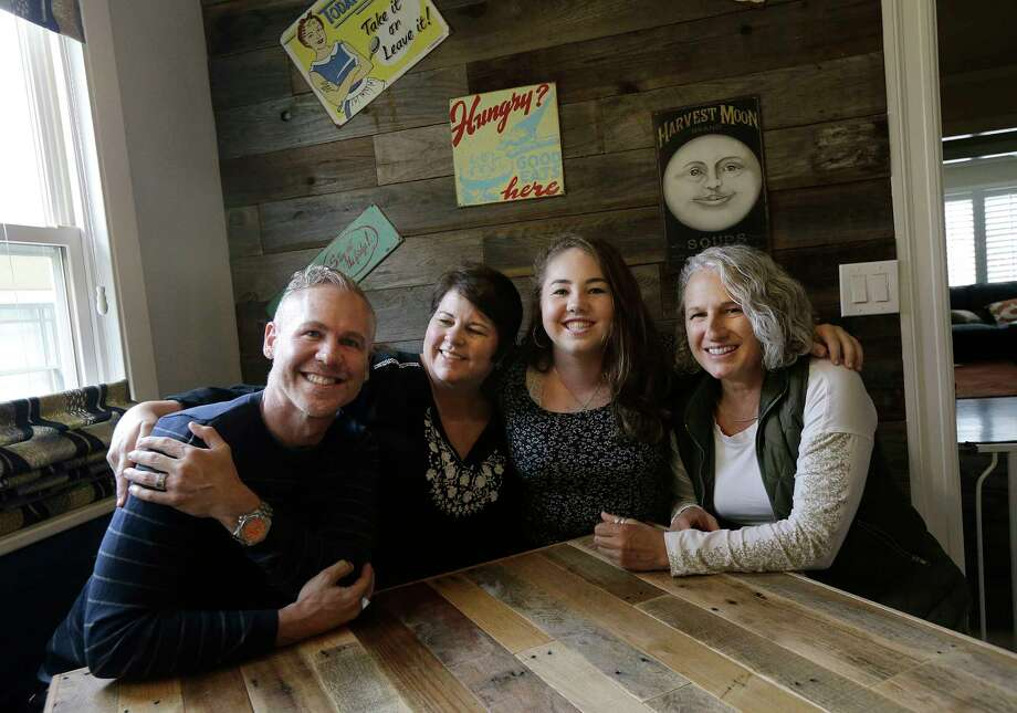 In this June 8, 2017 photo, Madison Bonner-Bianchi, second from right, poses for photos with her parents Mark Shumway, from left, Kimberli Bonner and Victoria Bianchi in Oakland, Calif. American courts have for decades granted some rights to grandparents, stepparents and others in children's lives, but parents have uniquely broad rights and responsibilities.  (AP Photo/Jeff Chiu) ORG XMIT: CAJC301 Photo: Jeff Chiu / Copyright 2017 The Associated Press. All rights reserved.