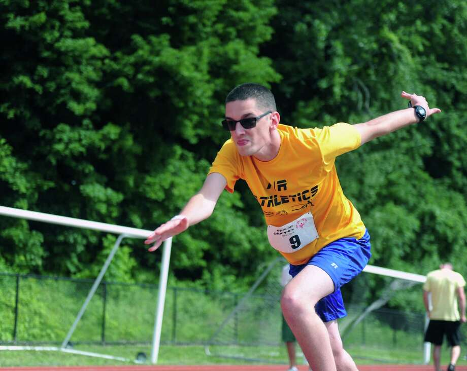 Ed Lawless runs the 200 meter at the Special Olympics at Hudson Valley Community College in Troy, N.Y. on Saturday, June 18, 2017. (Robert Downen/Times Union) Photo: Robert Downen