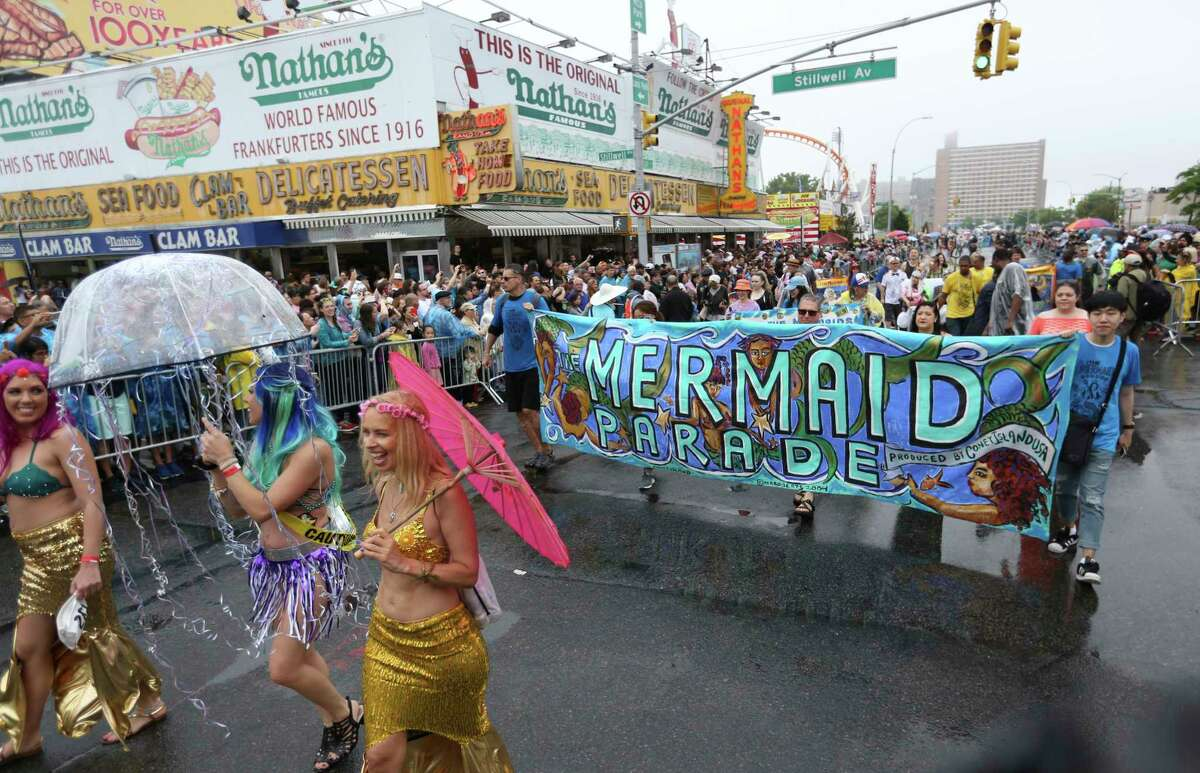 The 35th Annual Mermaid Parade passes Stillway Ave., Saturday, June 17, 2017, in New York's Coney Island. Thousands lined the streets in rain to take part in the annual parade. (AP Photo/Michael Noble Jr.) ORG XMIT: NYMN101
