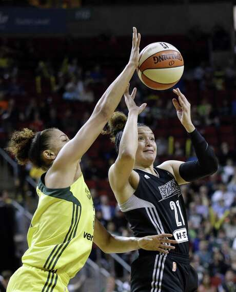 Seattle Storm's Alysha Clark, left, tries to knock the ball away from San Antonio Stars' Kayla McBride in the first half of a WNBA basketball game Sunday, June 18, 2017, in Seattle. (AP Photo/Elaine Thompson) Photo: Elaine Thompson, STF / Associated Press / Copyright 2017 The Associated Press. All rights reserved.