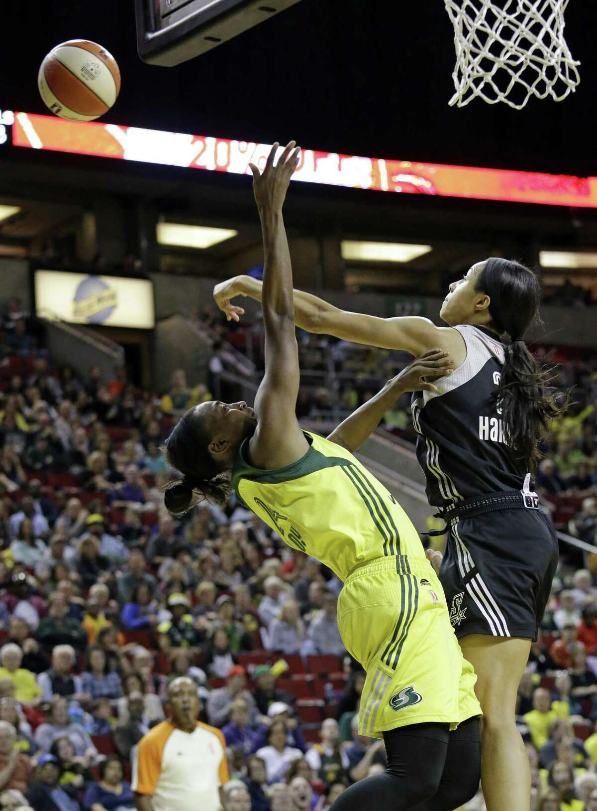 San Antonio Stars' Isabelle Harrison, right, blocks a shot by Seattle Storm's Jewell Loyd in the first half of a WNBA basketball game Sunday, June 18, 2017, in Seattle. (AP Photo/Elaine Thompson)