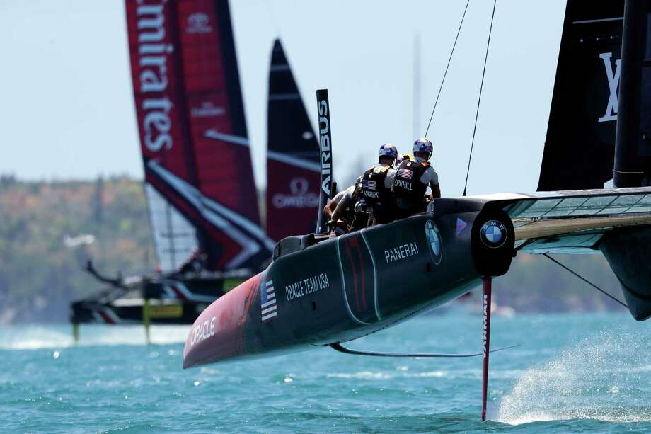 Oracle Team USA skipper and helmsman Jimmy Spithill, right, and teammates look on as they trail Emirates Team New Zealand, left, during the third race of America's Cup competition, Sunday, June 18, 2017, in Hamilton, Bermuda. (AP Photo/Gregory Bull) ORG XMIT: BMGB104 Photo: Gregory Bull / Copyright 2017 The Associated Press. All rights reserved.