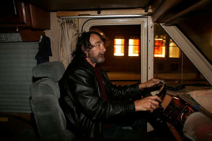 Robert Brownell moves his RV before midnight to avoid getting a parking ticket for street cleaning on Bryant Street in 2017. The issue of overnight RV parking continues to bedevil city transportation officials.