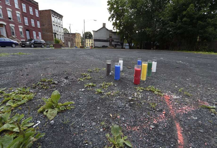 A 46-year-old man was fatally shot Sunday afternoon June 18, 2017, during a Father's Day barbecue in Albany's South End.A makeshift memorial stands at the site on June 19, 2017. (Skip Dickstein / Times Union) Photo: (Skip Dickstein / Times Union)
