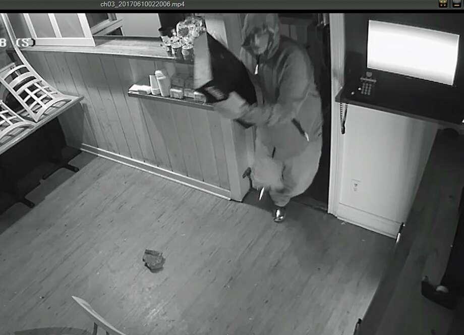 Police are asking the public's help to catch a pizza restaurant burglar. The burglary happened around 2:30 a.m. on June 10, 2017 at Rowayton Pizza on Rowayton Avenue. Photo: Norwalk PD