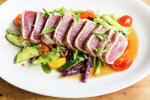 Seared tuna with Thai-style cucumber, tomato, and long bean salad from the new fish- and vegetable-focused menu at Underbelly.