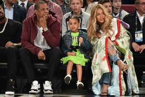 Jay Z, Blue Ivy Carter and Beyonce Knowles attend the 66th NBA All-Star Game at Smoothie King Center on February 19, 2017 in New Orleans, Louisiana.