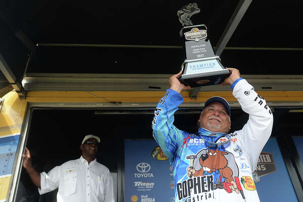 Orange's pro angler Carl Svebek celebrates after winning the tournament trophy on the final day of the Bassmaster Bass Pro Shop Open in Orange Saturday. Both the pro and co-angler trophies were won by Orange natives, to the applause of the crowd that filled the stage area for the results. Photo taken Saturday, June 17, 2017 Kim Brent/The Enterprise