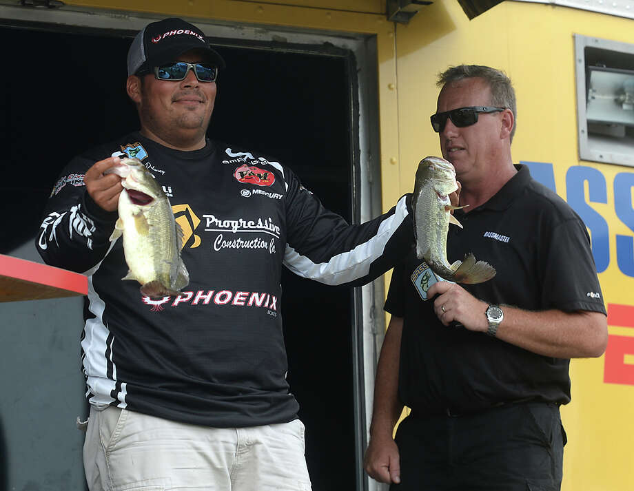 Angler Matthew Delaney shows his catch on the final weigh-in of the Bassmaster Bass Pro Shop Open in Orange Saturday. Both the pro and co-angler trophies were won by Orange natives, to the applause of the crowd that filled the stage area for the results. Photo taken Saturday, June 17, 2017 Kim Brent/The Enterprise Photo: Kim Brent / BEN