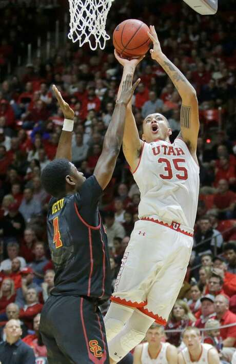 In this Jan. 12, 2017 photo, Utah forward Kyle Kuzma (35) goes to the basket as Southern California forward Chimezie Metu (4) defends in the second half during an NCAA college basketball game, in Salt Lake City. The Utah Jazz host a pair of familiar faces in Utah Utes Kyle Kuzma and David Collette for a predraft workout Tuesday, May 23, 2017. Kuzma has announced he will remain in the draft and looks to continue to impress after a strong combine. Collette is expected to return to school, where he should take over Kuzma's role as the top player on the roster. Photo: Rick Bowmer /AP Photo