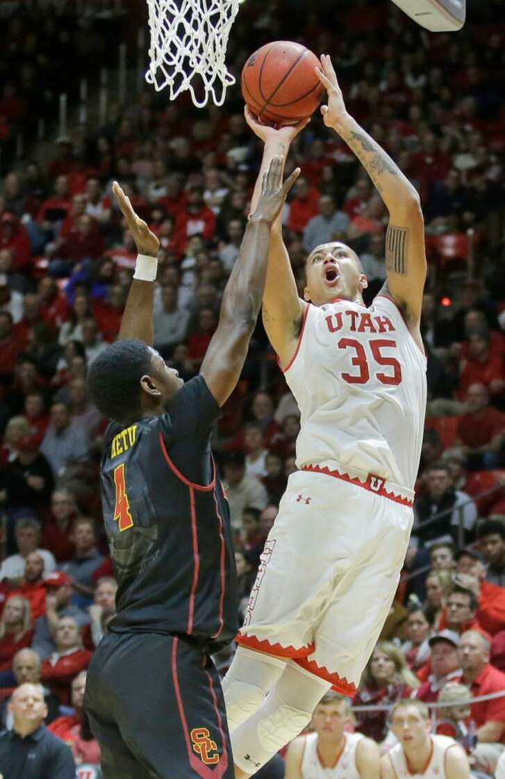 In this Jan. 12, 2017 photo, Utah forward Kyle Kuzma (35) goes to the basket as Southern California forward Chimezie Metu (4) defends in the second half during an NCAA college basketball game, in Salt Lake City. The Utah Jazz host a pair of familiar faces in Utah Utes Kyle Kuzma and David Collette for a predraft workout Tuesday, May 23, 2017. Kuzma has announced he will remain in the draft and looks to continue to impress after a strong combine. Collette is expected to return to school, where he should take over Kuzma's role as the top player on the roster.