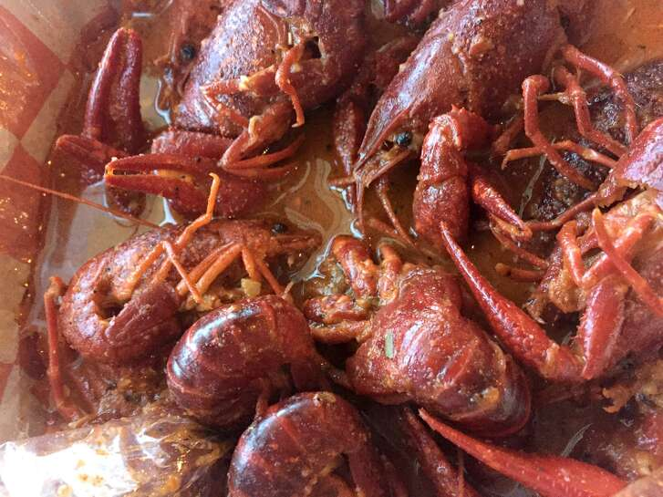 A bowl of crawfish swimming in a spicy Vietnamese chili sauce at Cajun Crawfish.