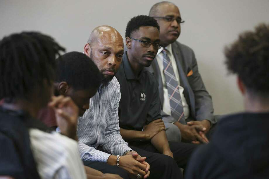 Members of the local chapter of 100 Black Men of America, from left, Warren Rosebrough, Patrick Gray and Ron Bright, counsel young men enrolled in a truancy prevention program at Eastside Education and Training Center, Wednesday, May 10, 2017. Photo: JERRY LARA / San Antonio Express-News / © 2017 San Antonio Express-News