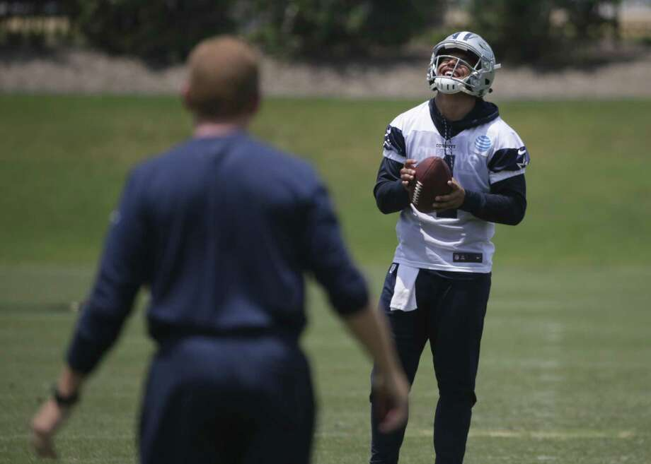 Dallas Cowboys quarterback Dak Prescott (4) laughs while playing a game of catch with head coach Jason Garrett, left, during an organized team activity at its NFL football training facility in Frisco, Texas, Wednesday, May 31, 2017. (AP Photo/LM Otero) Photo: LM Otero, STF / Associated Press / Copyright 2017 The Associated Press. All rights reserved.