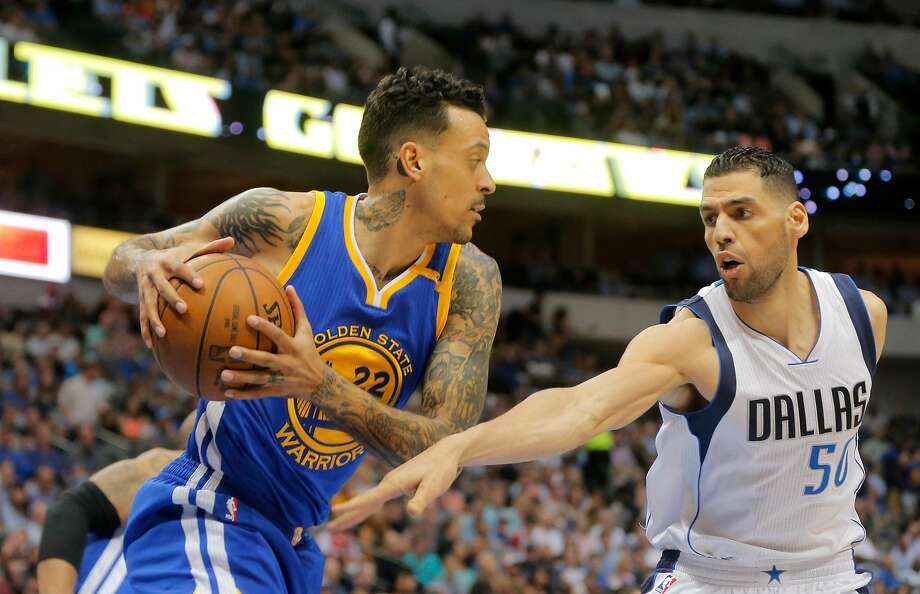 The Golden State Warriors' Matt Barnes (22) comes down with a rebound in front of the Dallas Mavericks' Salah Mejri (50) at American Airlines Center in Dallas on March 21, 2017. (Rodger Mallison/Fort Worth Star-Telegram/TNS) Photo: Rodger Mallison, TNS