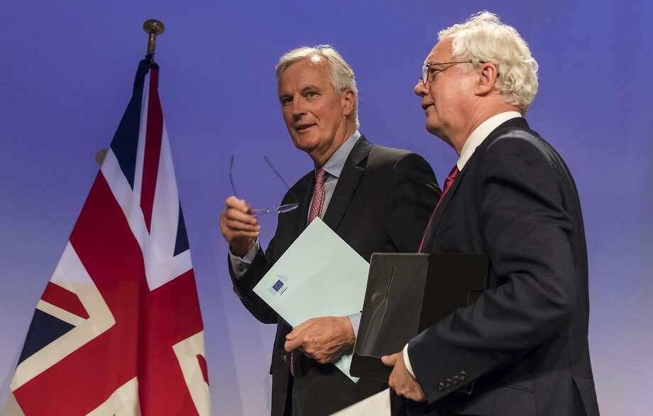 EU negotiator Michel Barnier (left) and his British counterpart David Davis confer in Brussels. Photo: Geert Vanden Wijngaert, Associated Press