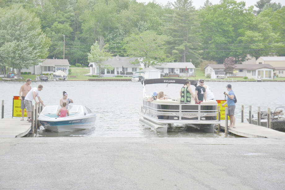 STEVE GRIFFIN | for the Daily News Boaters enjoy a summer day on Wixom Lake last year.