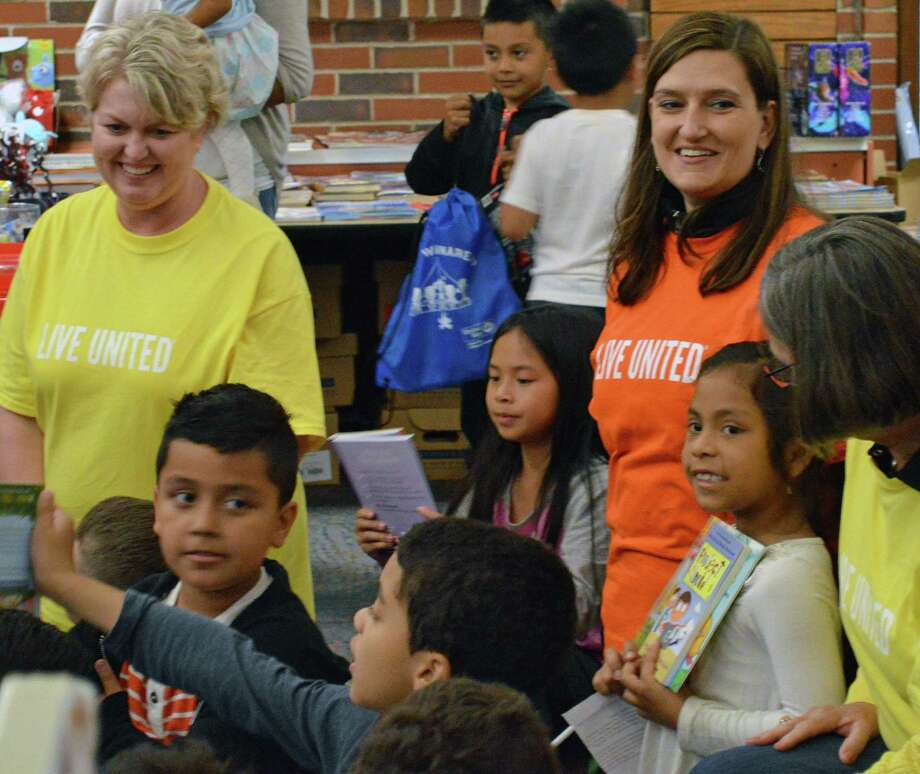 United Way CEO Kimberly Morgan, left, United Way Executive Vice President Isabel Almeida, and Cindy Merkle, president and CEO of Union Savings Bank and chair of United Way's board of directors, help deliver drawstring backpacks to second graders at South Street School as part of United Way's Day of Action on June 6. Photo: / Contributed Photo