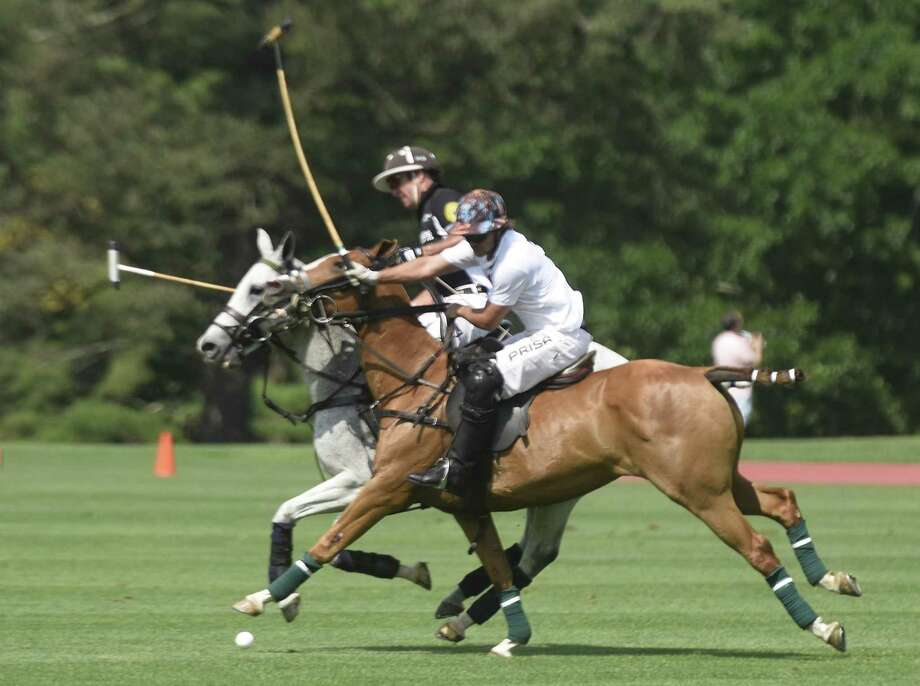 Cavalleria Toscana's Mike Davis, right, rides alongside Work to Ride's Joseph Manheim in the Monty Waterbury Cup tournament game between Work To Ride and Cavalleria Toscana at Greenwich Polo Club in Greenwich, Conn. Sunday, June 18, 2017. Work to Ride came from behind to defeat Cavalleria Toscana 13-12. The tournament will continue June 25 with the 20-goal USPA Monty Waterbury Cup final. Photo: Tyler Sizemore / Hearst Connecticut Media / Greenwich Time