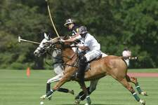 Cavalleria Toscana's Mike Davis, right, rides alongside Work to Ride's Joseph Manheim in the Monty Waterbury Cup tournament game between Work To Ride and Cavalleria Toscana at Greenwich Polo Club in Greenwich, Conn. Sunday, June 18, 2017. Work to Ride came from behind to defeat Cavalleria Toscana 13-12. The tournament will continue June 25 with the 20-goal USPA Monty Waterbury Cup final.