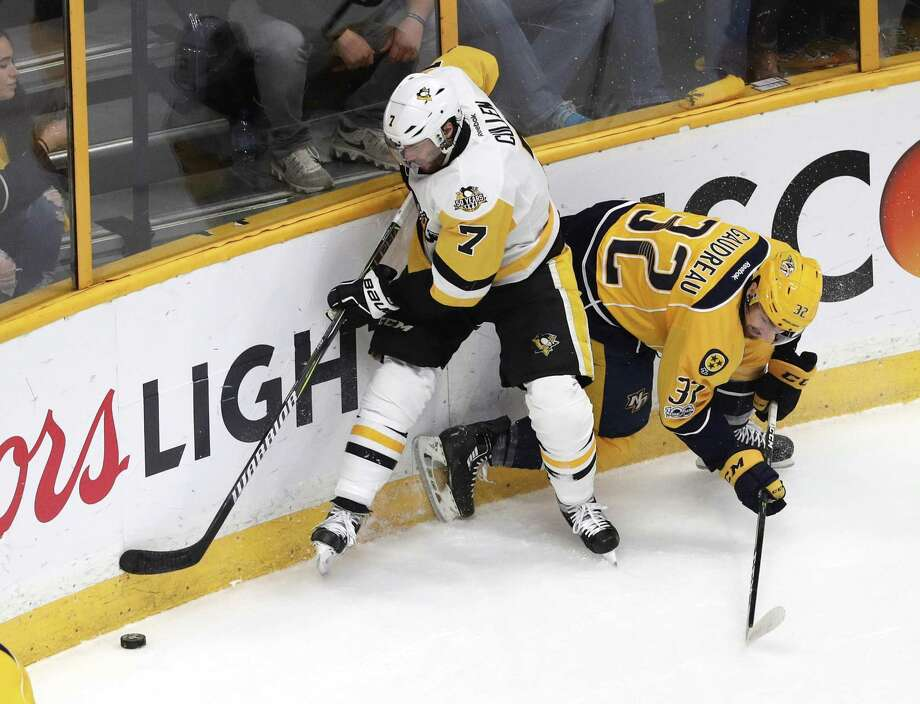 NASHVILLE, TN - JUNE 11: Matt Cullen #7 of the Pittsburgh Penguins battles for the puck with Frederick Gaudreau #32 of the Nashville Predators during the second period in Game Six of the 2017 NHL Stanley Cup Final at the Bridgestone Arena on June 11, 2017 in Nashville, Tennessee.  (Photo by Patrick Smith/Getty Images) Photo: Patrick Smith / Getty Images / 2017 Getty Images