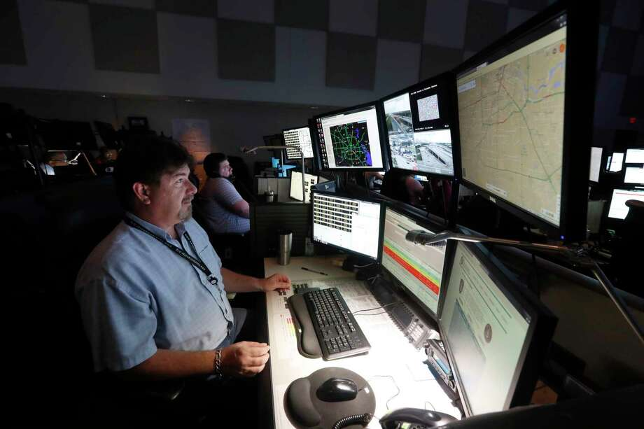 Devlin Cirtain monitors the Houston TranStar cameras for crashes at the agency's operations center on June, 6.  Houston City Council on Wednesday will discuss a $33.6 million project to add  91 dynamic messaging signs like the ones common on Houston freeways, 113 cameras at intersections and hundreds of signal detectors and wireless routers to transmit all the information back to traffic management officials, to improve traffic management. Photo: Karen Warren, Staff Photographer / 2017 Houston Chronicle