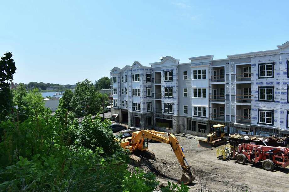Work continues on the Head of the Harbor apartment complex on Monday, June 19, 2017, in Norwalk, Conn. A Harvard University study ranked the Norwalk region in the bottom 10 of major metropolitan areas nationally for the burden of housing costs, whether for renters or owners. Photo: Alexander Soule / Hearst Connecticut Media / Stamford Advocate