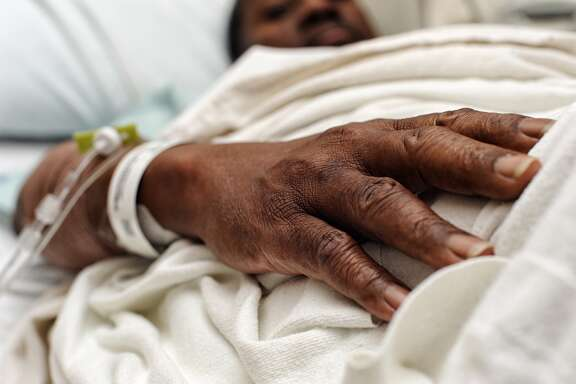 Hospital patient African American male in a hospital bed. Details Credit: Gerville