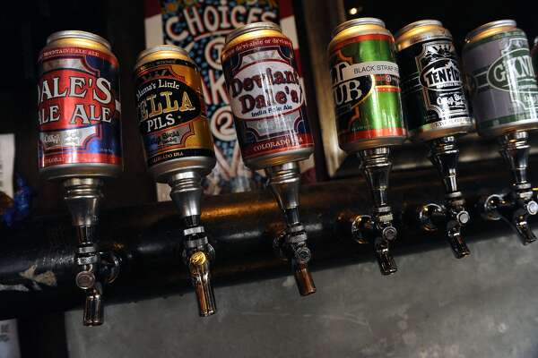 Oskar Blues' most popular beer is the Dale's Pale Ale, left, but Oskar Blues restaurant has 13 others on tap brewed at their brew pub in Lyons. Oskar Blues brewery, located at 1800 Pike Road in Longmont, has become an increasingly popular brewery selling 6 signatures beers in stores and 14 on tap. The brewery makes about 200 barrels of beer daily and has 27 fermentation tanks with two new ones coming in the next couple of weeks. Along with the brewery, Oskar Blues has a restaurant in Longmont as well as a brew pub in Lyons. Photo by Helen H. Richardson/The Denver Post (Photo By Helen H. Richardson/The Denver Post via Getty Images)
