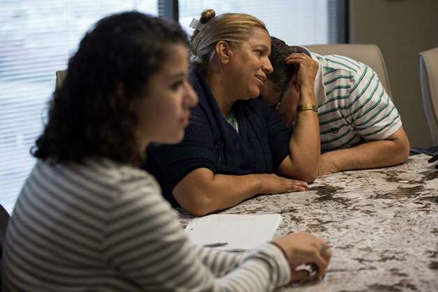Celia Rodriguez comforts her husband Juan Rodriguez in the offices of their attorneys, Monday, June 19, 2017, in Houston. Photo: Marie D. De Jesus, Houston Chronicle / © 2017 Houston Chronicle