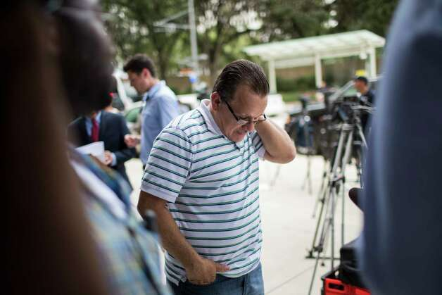 Juan Rodriguez closes his eyes and lowers his head exhausted after a press conference on which it was announced that his daughters and wife filed a lawsuit against the federal government, Monday, June 19, 2017, in Houston. Photo: Marie D. De Jesus, Houston Chronicle / © 2017 Houston Chronicle