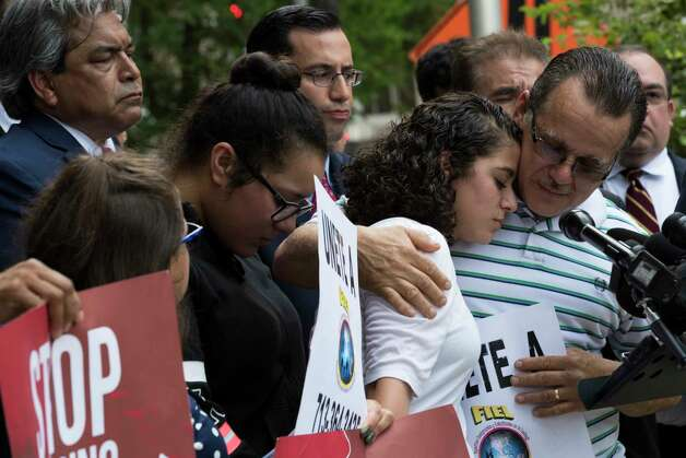 Juan Rodriguez, right, holds his daughter Karen Rodriguez during a press conference on front of the United States District Court for the Southern District of Texas announcing a lawsuit his daughters have submitted  against the federal government, Monday, June 19, 2017, in Houston. Photo: Marie D. De Jesus, Houston Chronicle / © 2017 Houston Chronicle