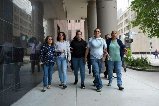 (left to right) Kimberly Rodriguez, 15, Karen Rodriguez, 18, Rebecca Rodriguez, 15, Juan Rodriguez and Celia Rodriguez walk holding hands to the United States District Court for the Southern District of Texas, Monday, June 19, 2017, in Houston. Photo: Marie D. De Jesus, Houston Chronicle / © 2017 Houston Chronicle
