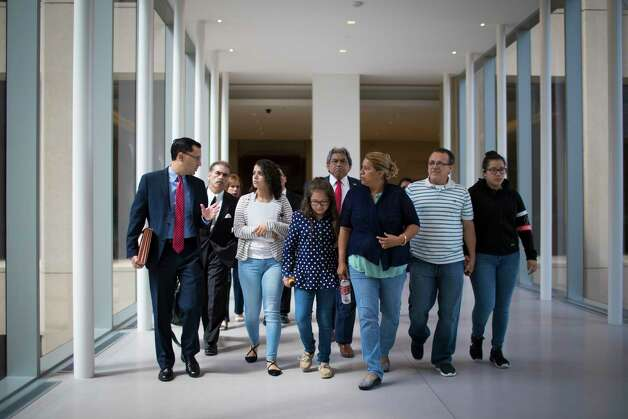The Rodriguez family walk toward the United States District Court for the Southern District of Texas with their attorneys, Monday, June 19, 2017, in Houston. Photo: Marie D. De Jesus, Houston Chronicle / © 2017 Houston Chronicle