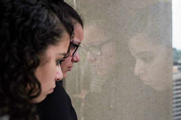 Emotional and tense about an upcoming press conference, Rebecca Rodriguez, 15, and her sister Karen Rodriguez, 18, look out the window from the 14th floor of the Two Allen Center (1200 Smith Street), Monday, June 19, 2017, in Houston. Photo: Marie D. De Jesus, Houston Chronicle / © 2017 Houston Chronicle