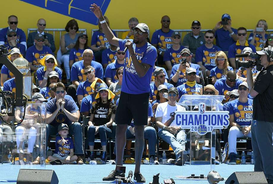OAKLAND, CA - JUNE 15:  Kevin Durant #35 of the Golden State Warriors talks to the fans while they celebrate the Warriors 2017 NBA Championship at The Henry J. Kaiser Convention Center during thier Victory Parade and Rally on June 15, 2017 in Oakland, California.  (Photo by Thearon W. Henderson/Getty Images) Photo: Thearon W. Henderson, Getty Images
