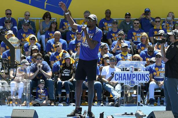 OAKLAND, CA - JUNE 15:  Kevin Durant #35 of the Golden State Warriors talks to the fans while they celebrate the Warriors 2017 NBA Championship at The Henry J. Kaiser Convention Center during thier Victory Parade and Rally on June 15, 2017 in Oakland, California.  (Photo by Thearon W. Henderson/Getty Images)