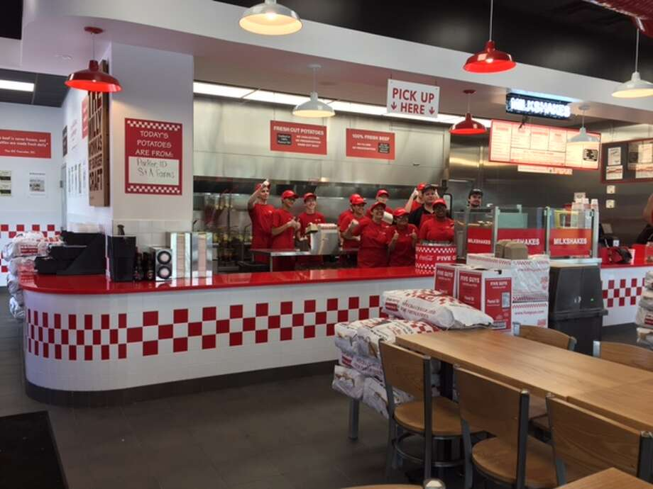 Bill Menconi of New Milford was the first customer at the new Five Guys Location at 162 Danbury Rd. in New Milford on June 19, 2017.  Photo: Bill Menconi