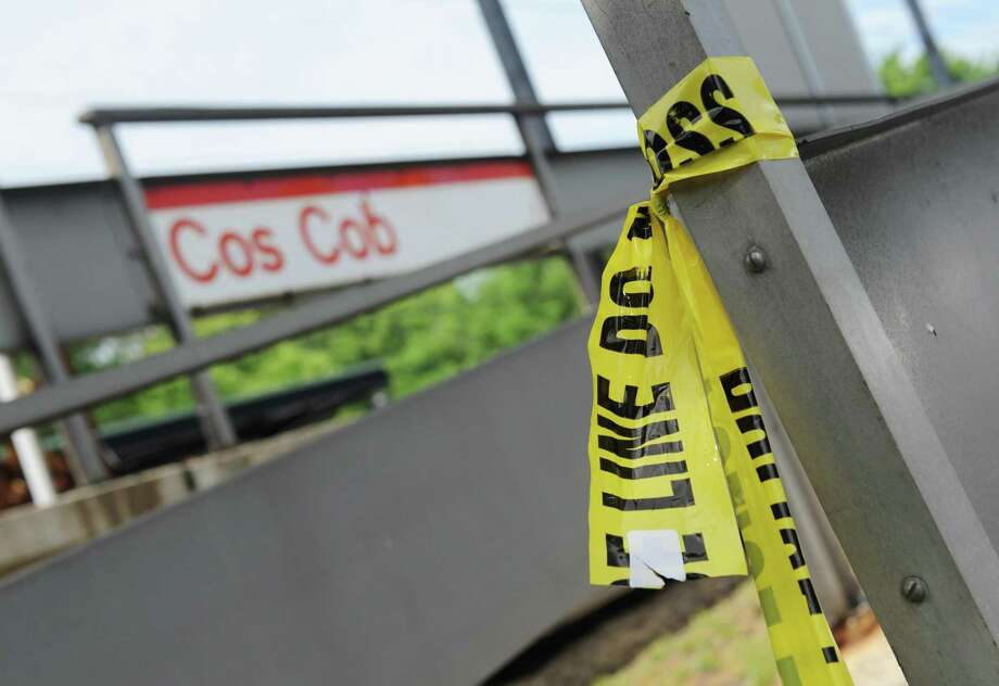 Police tape remains at the Cos Cob Metro-North station on Monday. , June 19, 2017. A 17-year-old Greenwich High School student was struck and killed by a Metro-North train just after midnight Sunday, June 18, 2017 near the Cos Cob train station. Photo: Tyler Sizemore / Hearst Connecticut Media / Greenwich Time
