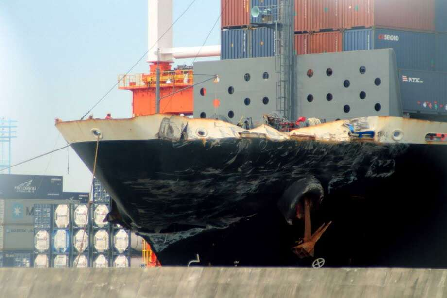 The container ship ACX Crystal with its left bow dented and scraped after colliding with the USS Fitzgerald in the waters off the Izu Peninsula on Saturday, June 17, 2017, is berthed at the Yokohama port near Tokyo, Monday, June 19, 2017. The ships collided about early Saturday, when the Navy said most of the 300 sailors on board would have been sleeping, and authorities have declined to speculate on a cause while the crash remains under investigation.(Hiroshi Kashimura/Kyodo News via AP) Photo: Hiroshi Kashimura / Associated Press / Kyodo News