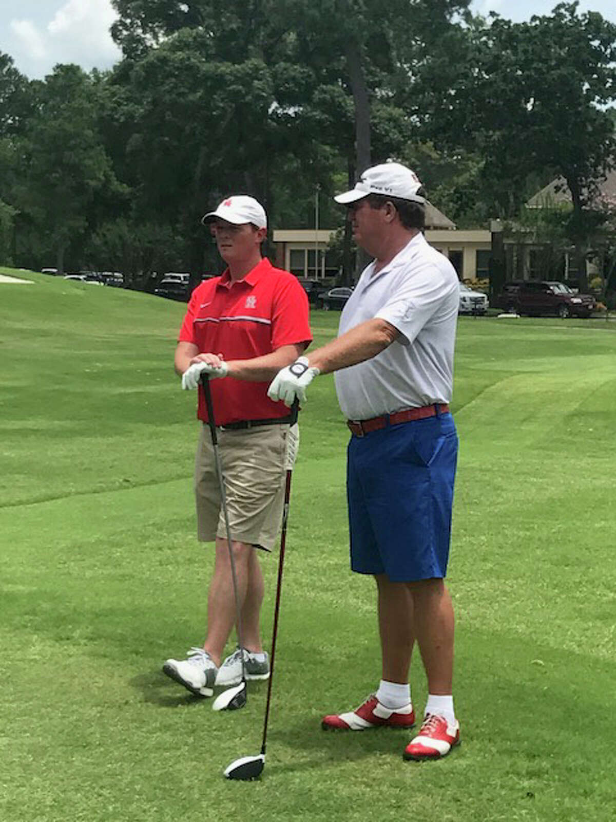 Major Applewhite (left) and Steve Elkington chat during the golf tournament Monday at Kingwood Country Club.