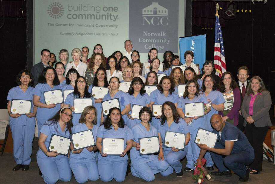 The home health aide graduating class with staff and leadership from Building One Community and Norwalk Community College at a ceremony for the joint program. Photo: Contributed / © 2017 Bill Gordon Photography