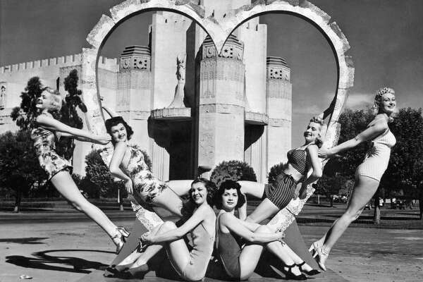 These six young women are ready for St Valentine's Day as they surround a heart at the South Tower of the Golden Gate International Exposition on Treasure Island, San Francisco, California, February 14, 1940. (Photo by Underwood Archives/Getty Images)